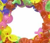Colorful plastic cups for latex balloon on white with copy space — Stock Photo