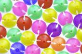 Colorful plastics plastic cup for latex balloon — Stock Photo
