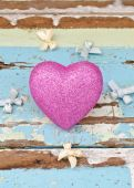 Pink hearts and ribbons on grungy light blue wooden background — Photo