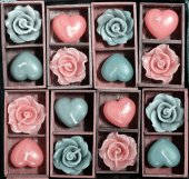 Candle roses and candle hearts in wooden box — Stock Photo