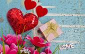Gift and hearts on wooden board, Valentines Day backgroun — Stock Photo