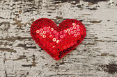 Red heart shape on wood background in vintage style — Stock Photo