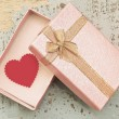 Red heart in gift box on grunge wood background in vintage style — Stock Photo #67548749