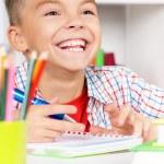 Boy doing homework — Stock Photo #53737379