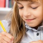 Girl doing homework — Stock Photo #54729611