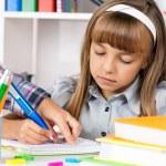 Girl doing homework — Stock Photo #54729687