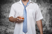 Man with alcohol in hand grunge — Stock Photo