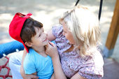 Mother playing with son in park — Stock Photo