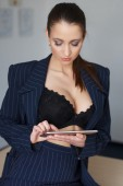 Brunette office worker online flirt by tablet — Stock fotografie