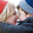 Mother and son huddle together winter portrait — Stock Photo #53189017