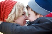 Mother and son huddle together winter portrait — Stock Photo