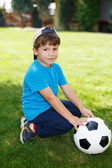 Little boy in cap with soccer ball — Stock Photo