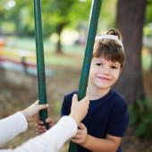 Little boy sit on swing — Stockfoto
