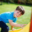 Little boy climbing on slide — Stock Photo #54700341