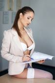 Sexy secretary in underwear on desk — Stock Photo