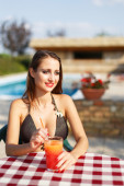 Brunette woman in bikini with fresh juice — Foto Stock