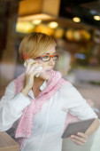 Confident blonde manager speak loud into the phone — Stock Photo
