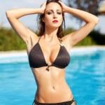 Sexy woman in bikini posing — Stock Photo #56629317