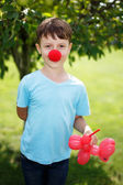 Little boy with red clown nose — Stock Photo