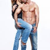 Fashionable sexy couple at wall — Stock Photo