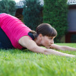 Young woman practice yoga outdoor — Stock Photo #59702777