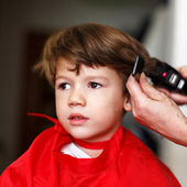 Little boy in hair saloon — Stock Photo