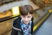 Little boy on escalator — Foto de Stock
