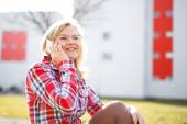 Woman in flannel shirt calling outdoor — Stock Photo