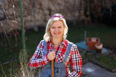 Blonde woman in flannel shirt and glasses outdoor works — Stock Photo