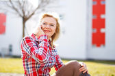 Fresh woman in flannel shirt calling outdoor — Stock Photo