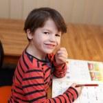 Preschooler genius boy solving math exercise — Stock Photo #70549103