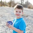 Little boy holding clean water in dotted mug — Stock Photo #71118953