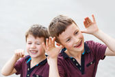 Little hyperactive brothers playing outdoor — Stock Photo