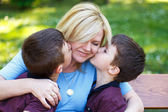 Mother with two sons in park — Stock Photo