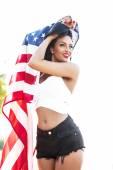 Sexy woman holding usa flag outdoor — Stock Photo