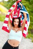 Sexy woman with usa flag outdoor — Stock Photo