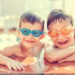 Boys laughing in pool — Stock Photo #78852062