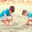 Little boys build sand fortress — Stock Photo #80483542