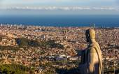 Sculpture of Apostle and view of Barcelona — Stock Photo