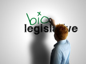 Bio legislative. Boy writing on a white board — Stock Photo