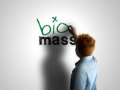 Bio mass. Boy writing on a white board — Stock Photo