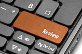 Review. Orange hot key on computer keyboard — Stock Photo