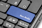 Mass Media. Blue hot key on computer keyboard — Stock Photo