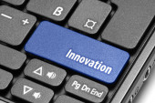Innovation. Blue hot key on computer keyboard — Stock Photo