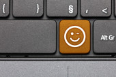 Wink. Orange hot key emoticon on computer keyboard. — Stock Photo