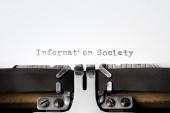 """Information Society"" written on an old typewriter — Stok fotoğraf"
