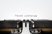 """Stock Exchange"" written on an old typewriter — Stok fotoğraf"