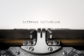 """Software Sollutions"" written on an old typewriter — Stok fotoğraf"