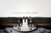 """Sustainable development"" written on an old typewriter — Stok fotoğraf"