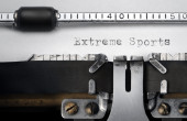"""Extreme Sports"" written on an old typewriter — Stock fotografie"